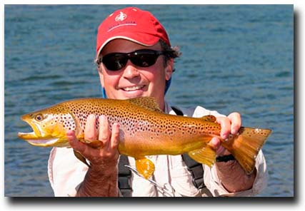 Alberto Cordero with a nice Brown Trout landed on a dry fly.