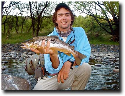 Fly Fishing Andes Guide with a nice Malleo Brown, Courtesy of Rick Bannerot
