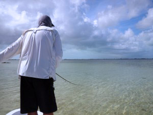 """Angler demonstrates a perfect """"strip set"""". Left hand removes slack in the line. Right hand keeps the rod tip pointed down. The resulting tension sets the hook."""